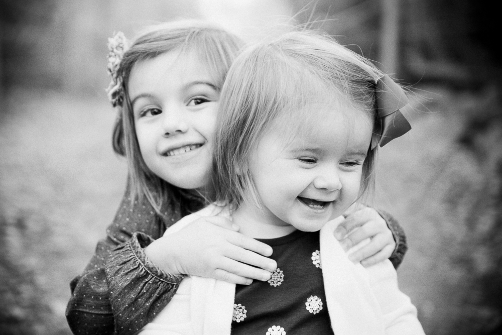 siblings, sisters, black and white, laugh